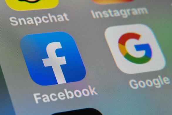 Úc buộc Facebook, Google trả tiền bản quyền tin tức - Ảnh 1