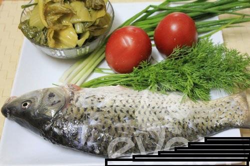 Cách nấu canh cá dưa chua thơm ngọt cho bữa trưa nắng nóng  - Ảnh 1