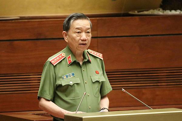 Bộ trưởng Công an Tô Lâm mở màn phiên chất vấn trước Quốc hội  - Ảnh 1