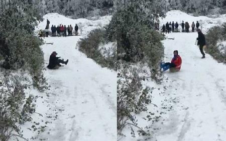 Video: Tuyết phủ trắng Sapa, người dân vui thích chơi trượt tuyết - Ảnh 1