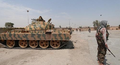 Quân đội chính phủ Syria và lực lượng người Kurd bất đồng vụ lập căn cứ Mỹ - Ảnh 1
