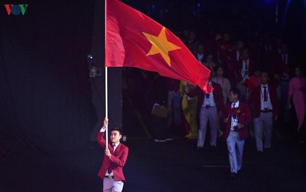 Phần diễu hành của đoàn thể thao Việt Nam trong lễ khai mạc SEA Games 30 - Ảnh 2