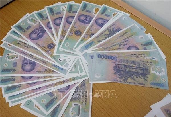 Ngân hàng Nhà nước hướng dẫn phân biệt tiền thật - tiền giả - Ảnh 1