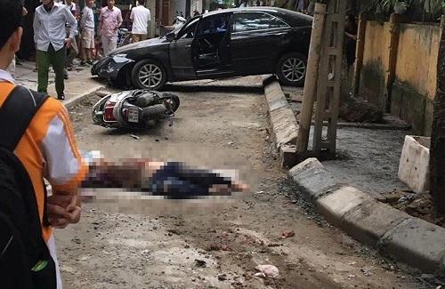 Xác định danh tính nữ tài xế lùi Camry cán chết người đi xe máy trên phố Hà Nội - Ảnh 1