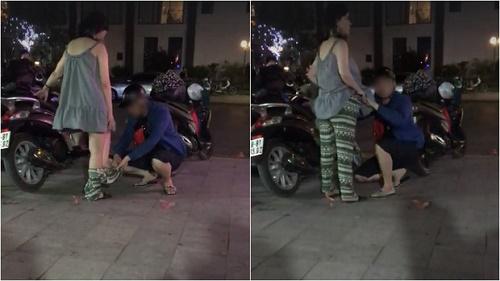 """Chồng mặc quần cho vợ bầu ngay giữa phố: Người ngưỡng mộ, kẻ ngáo ngán """"kém duyên"""" - Ảnh 1"""