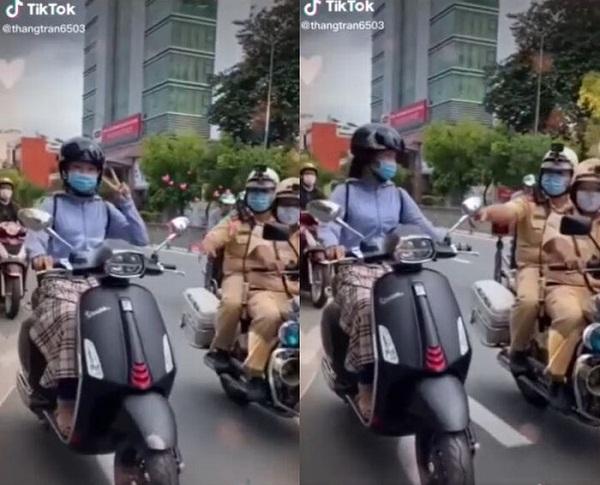 """Giơ ngón tay lên chụp hình khi đang đi xe máy, cô gái """"chết đứng"""" vì 2 nhân vật xuất hiện phía sau - Ảnh 2"""