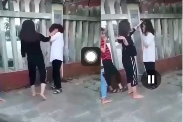 Quảng Bình: Thêm nữ sinh bị túm tóc, tát rồi quay clip rồi tung lên mạng - Ảnh 2