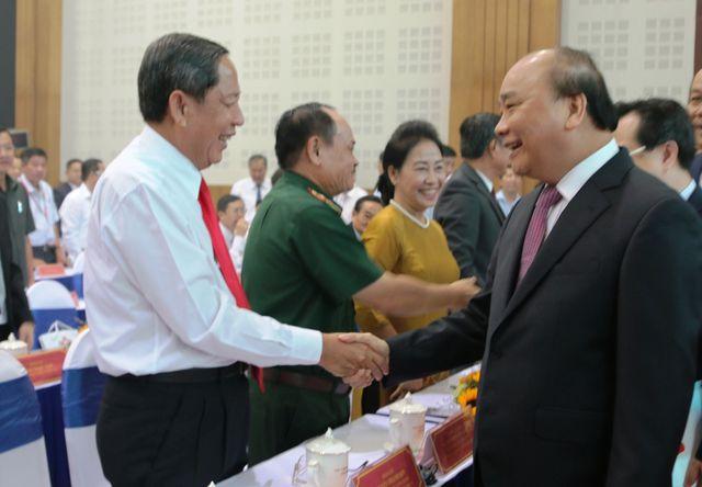 Thủ tướng Nguyễn Xuân Phúc: Không chấp nhận những doanh nghiệp lợi dụng lỗ hổng pháp luật để trục lợi - Ảnh 1