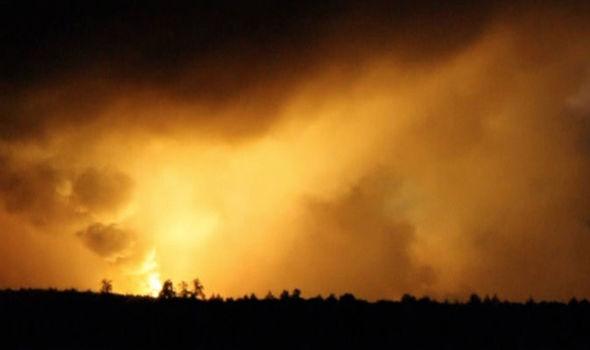 Nổ kho vũ khí lớn khiến miền bắc Ukraine rung chuyển  - Ảnh 1