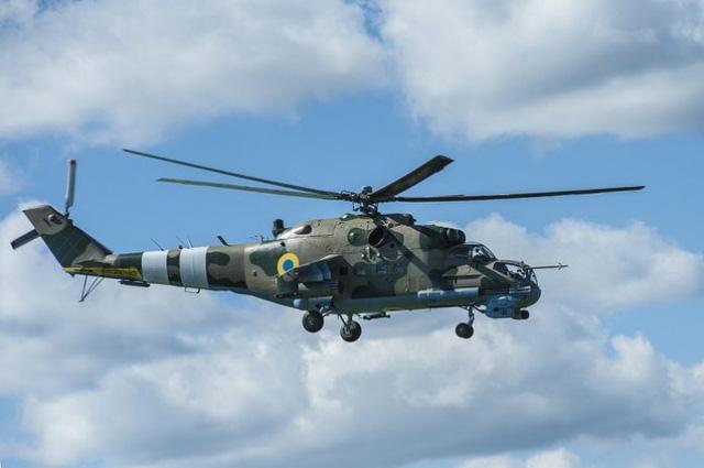 Tiết lộ video trực thăng Mi-24 bắn hạ máy bay không người lái của Nga - Ảnh 1