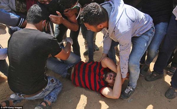 Israel bắn chết hàng chục người biểu tình phản đối Mỹ mở đại sứ quán ở Jerusalem - Ảnh 9