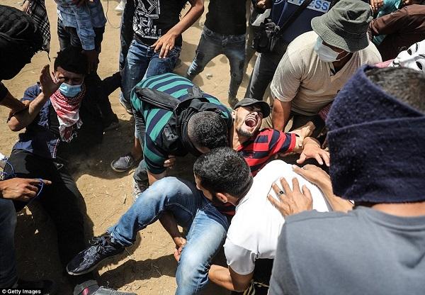 Israel bắn chết hàng chục người biểu tình phản đối Mỹ mở đại sứ quán ở Jerusalem - Ảnh 5