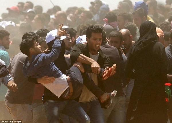 Israel bắn chết hàng chục người biểu tình phản đối Mỹ mở đại sứ quán ở Jerusalem - Ảnh 12