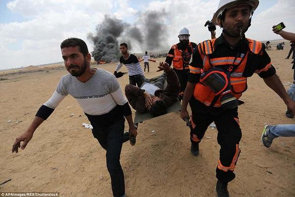 Israel bắn chết hàng chục người biểu tình phản đối Mỹ mở đại sứ quán ở Jerusalem - Ảnh 7