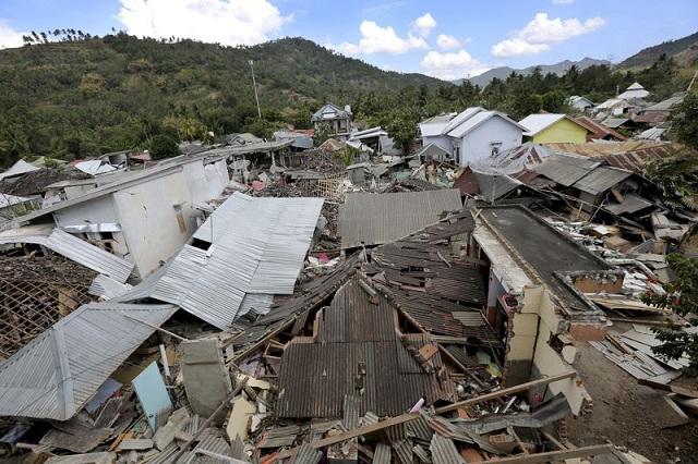 Động đất tại Indonesia: Số thương vong lên tới hơn 14.000 người - Ảnh 3
