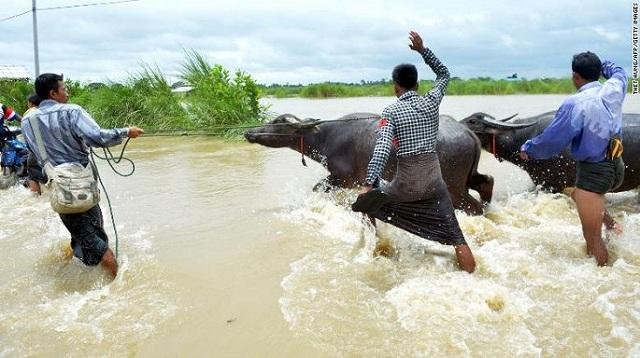 Hiện trường vỡ đập tại Myanmar khiến hơn 100 ngôi làng ngập trong nước lũ - Ảnh 8