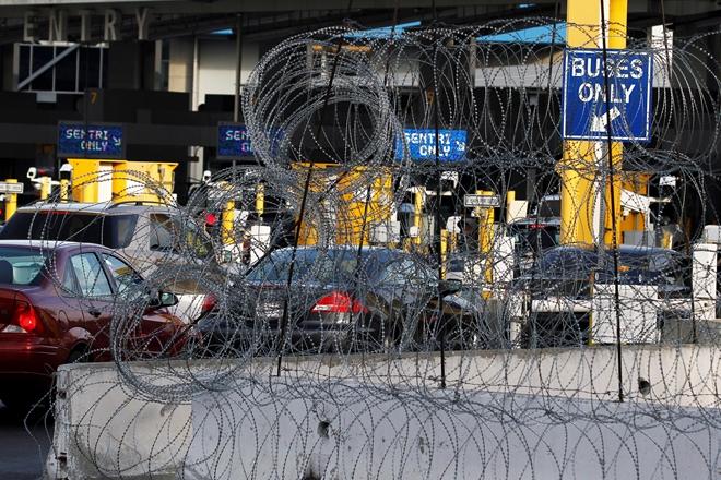 Mỹ điều thêm 750 sĩ quan tới biên giới nhằm ngăn chặn dòng người di cư - Ảnh 1