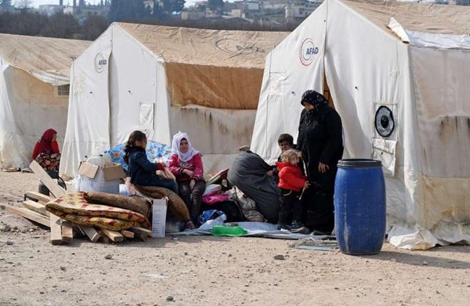 Xót xa cảnh hàng trăm nghìn dân thường phải chạy trốn khỏi Idlib, giữa bối cảnh giao tranh ác liệt - Ảnh 9