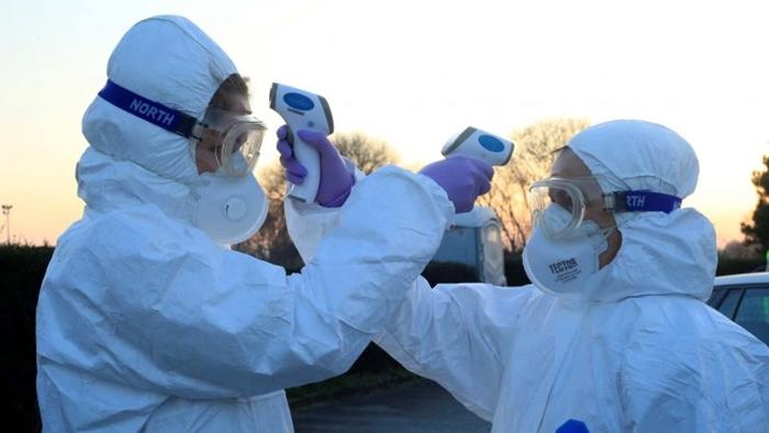 Những bức ảnh đáng chú ý về đại dịch Covid-19 đang làm xáo trộn cuộc sống trên toàn thế giới - Ảnh 1