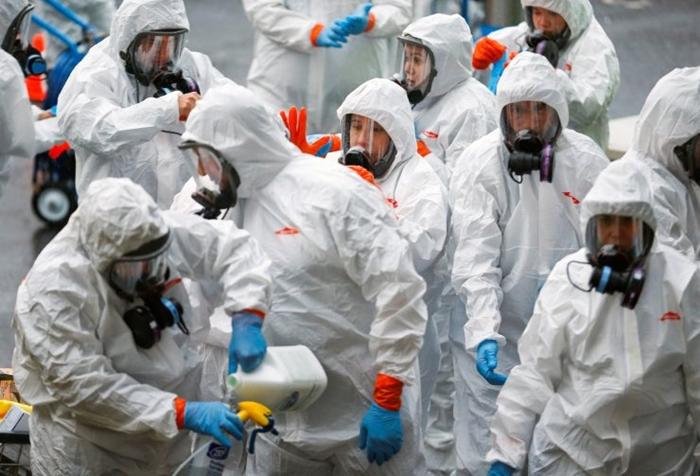 Những bức ảnh đáng chú ý về đại dịch Covid-19 đang làm xáo trộn cuộc sống trên toàn thế giới - Ảnh 12