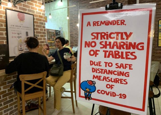 """Chống dịch Covid-19 """"một mình một kiểu"""", Singapore đối mặt nguy cơ """"vỡ trận""""? - Ảnh 7"""