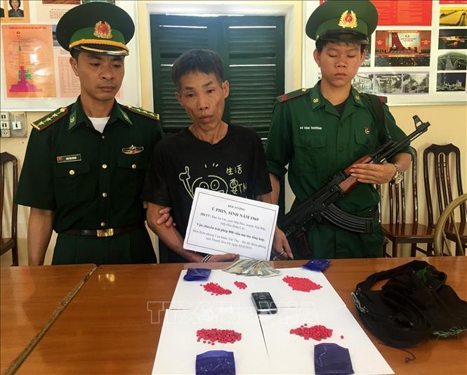 Bắt đối tượng người Lào vận chuyển 800 viên hồng phiến vào Việt Nam tiêu thụ - Ảnh 1