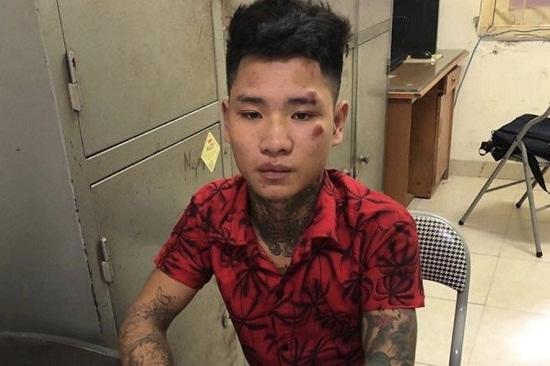 Hà Nội: Khởi tố nam thanh niên xăm trổ tông gục chiến sĩ CSGT giữa đường - Ảnh 1