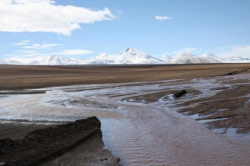 Biến đổi khí hậu: Sa mạc khô cằn nhất thế giới bất ngờ bị ngập lụt - Ảnh 1