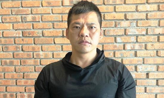 Tạm giữ người đàn ông Trung Quốc trốn truy nã khi đang nhập cảnh vào Đà Nẵng - Ảnh 1