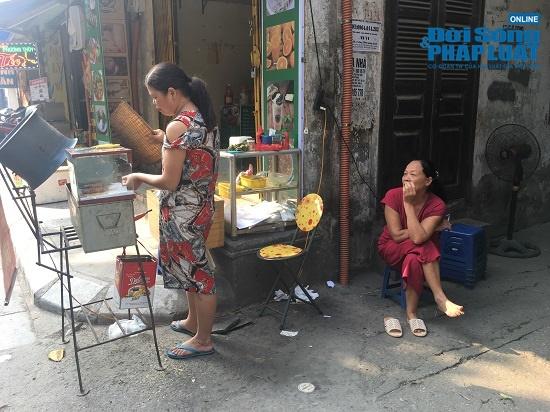 Vụ cháy công ty Rạng Đông: Phố Hạ Đình đông đúc sau nhiều ngày vắng vẻ, người dân yên tâm về nhà - Ảnh 13