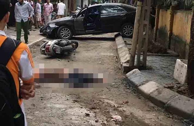 Hiện trường vụ nữ tài xế xe Camry lùi xe cán chết người trên phố Hà Nội - Ảnh 1