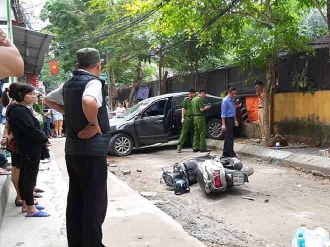 Nữ tài xế xe Camry lùi xe cán chết người trên phố Hà Nội - Ảnh 1