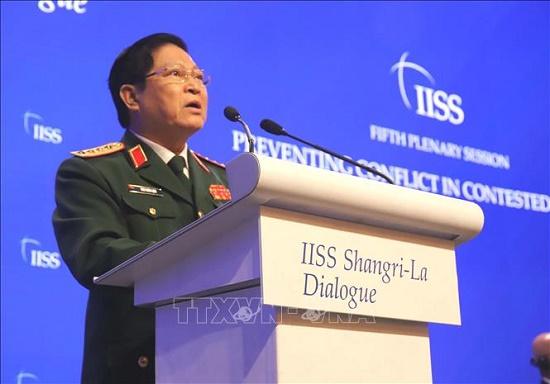 Bộ trưởng Ngô Xuân Lịch nêu quan điểm giải quyết tranh chấp trong hòa bình và đối thoại - Ảnh 1