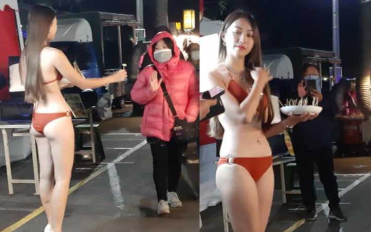 """Diện bikini để bán ổi bất chấp lạnh 9 độ C, cô gái xinh đẹp khiến dân tình """"tròn mắt"""" - Ảnh 1"""