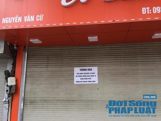Hà Nội: Phố phường vắng lặng, nhiều cửa hàng, quán xá tạm đóng cửa trong mùa dịch Covid-19 - Ảnh 3