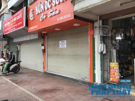 Hà Nội: Phố phường vắng lặng, nhiều cửa hàng, quán xá tạm đóng cửa trong mùa dịch Covid-19 - Ảnh 4