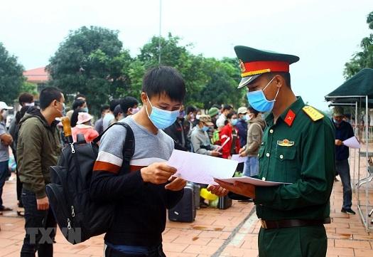 Huy động 100 xe buýt đưa người hết cách ly từ Hà Nội về địa phương - Ảnh 1
