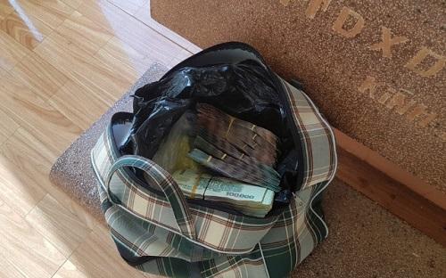 Chủ quán cơm ở Bình Phước nhặt được túi xách chứa 280 triệu đồng - Ảnh 1
