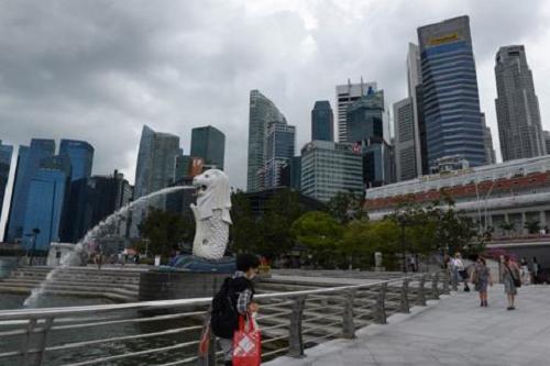 Singapore phát hiện hơn 10 trường hợp đầu tiên dương tính với virus SARS-CoV-2 biến thể - Ảnh 1