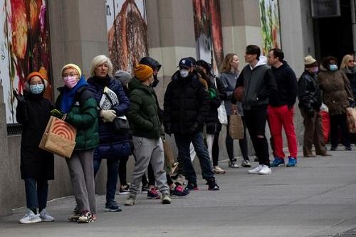 Giữa dịch Covid-19, Mỹ tiếp nhận thêm hơn 5,2 triệu đơn xin trợ cấp thất nghiệp mới - Ảnh 1