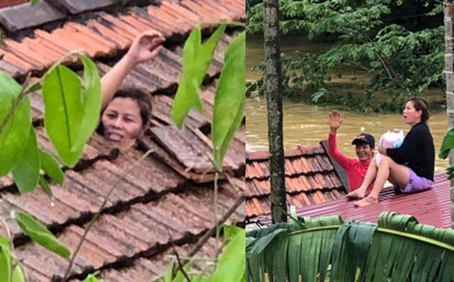 Xót xa hình ảnh người mẹ cùng con 1 tháng tuổi kẹt trong nhà, dỡ ngói kêu cứu giữa biển nước lũ - Ảnh 1