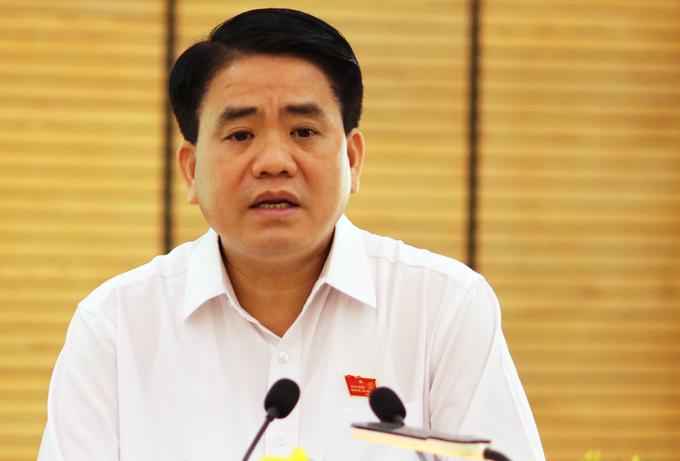 Ông Nguyễn Đức Chung bị tạm đình chỉ tư cách đại biểu HĐND TP.Hà Nội - Ảnh 1