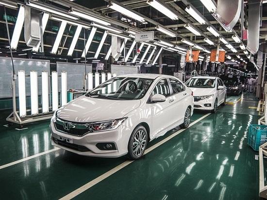 Người Việt mua ô tô trước Tết 2021 tăng trưởng mạnh so với năm ngoái  - Ảnh 1