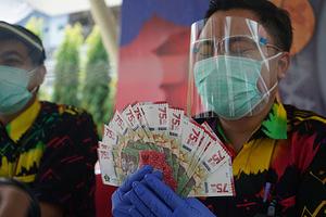 Cận cảnh đồng tiền mới của Indonesia gây tranh cãi vì bị nghi có yếu tố Trung Quốc - Ảnh 4