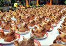 Tin trong nước - Nữ đại gia dâng 300 đầu heo lên chùa: Nên hay không?
