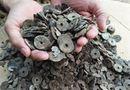 Tin trong nước - Nghệ An: Đào móng nhà, phát hiện hũ sành chứa 10kg tiền cổ