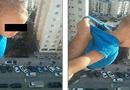 """Tin thế giới - Treo con ngoài cửa sổ tầng 15 để """"câu"""" like Facebook, bố lãnh án tù"""