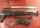 An ninh - Hình sự - Tạm giữ thanh niên 9X vác súng AK bắn thị uy đối thủ tại sân bóng