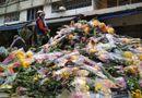 """Tin tức - Bị """"dội hàng"""", chủ hàng đem đổ 200 thùng, hoa tươi chất đống bên đường"""