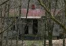 An ninh - Hình sự - Vụ thi thể phụ nữ đang phân hủy trong nhà hoang: Nghi can 55 tuổi chết trong tư thế treo cổ